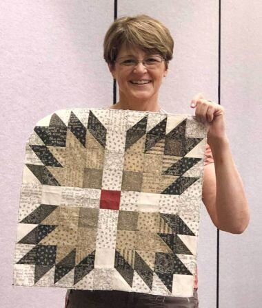 Kathy sharing her block at Spring Quilt Market.