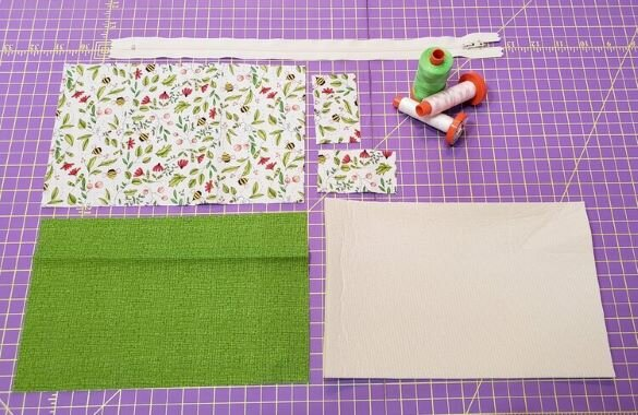 Start by cutting the fabrics for the outside, inside lining, and then cut the foam. Cut your shapes for the tabs. Fabrics shown here are from  PAINTED MEADOW  by Robin Pickens