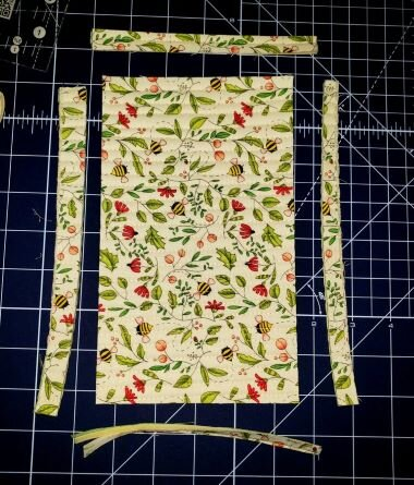 Layer your fabrics and foam, then quilt. Quilting is optional if you use a fusible foam stabilizer like  IN-R- FOAM.  Trim up your quilted piece as directed in the pattern.