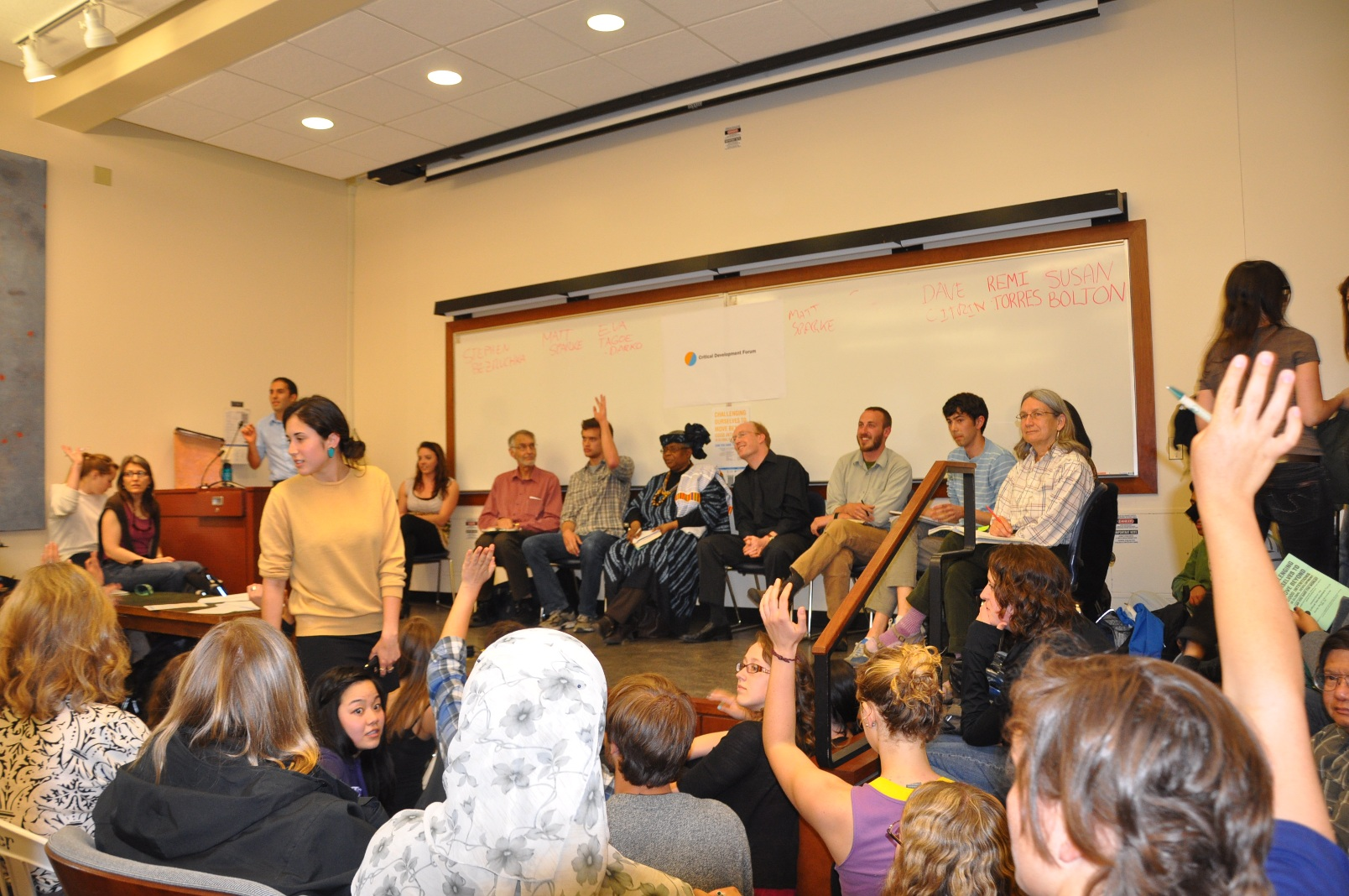 "Photo by Tom Paulson of our May 2011 panel, ""Can You Save the World?"" (a tongue-in-cheek title) which drew over 250 students into a tiny room to debate their role in global development and global justice efforts"