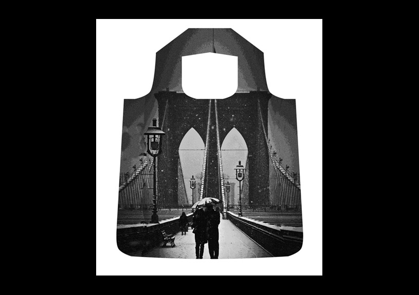 Brooklyn Bridge Shopper's Tote  .  Photo of a couple on the Brooklyn Bridge in the snow.