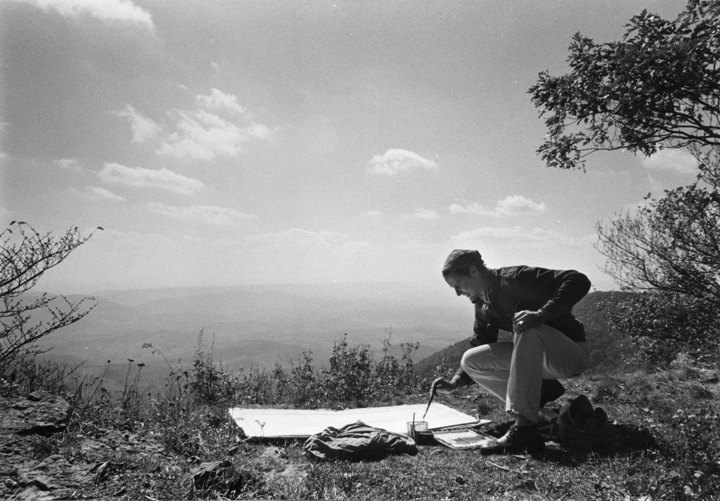 Ray Kass painting the view from an overlook at Mountain Lake Hotel PHOTOGRAPH: SUSAN SHATTER, 1976