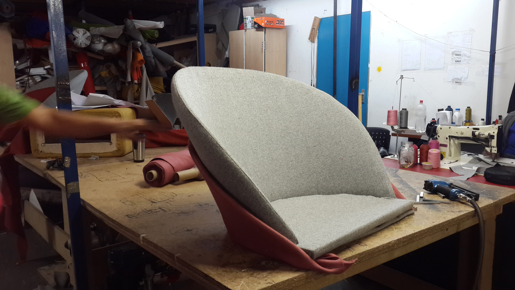 Final upholstery detailing on the reception chair