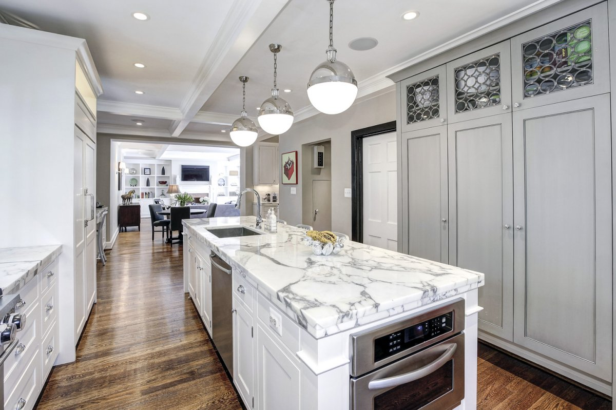 the-kitchen-is-bright-and-updated-with-marble-countertops-and-luxury-appliances.jpg