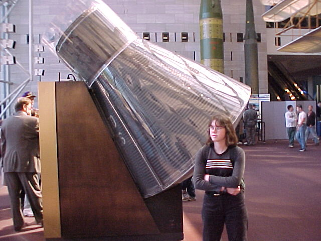 Steph in front of the Gemini re-entry module.
