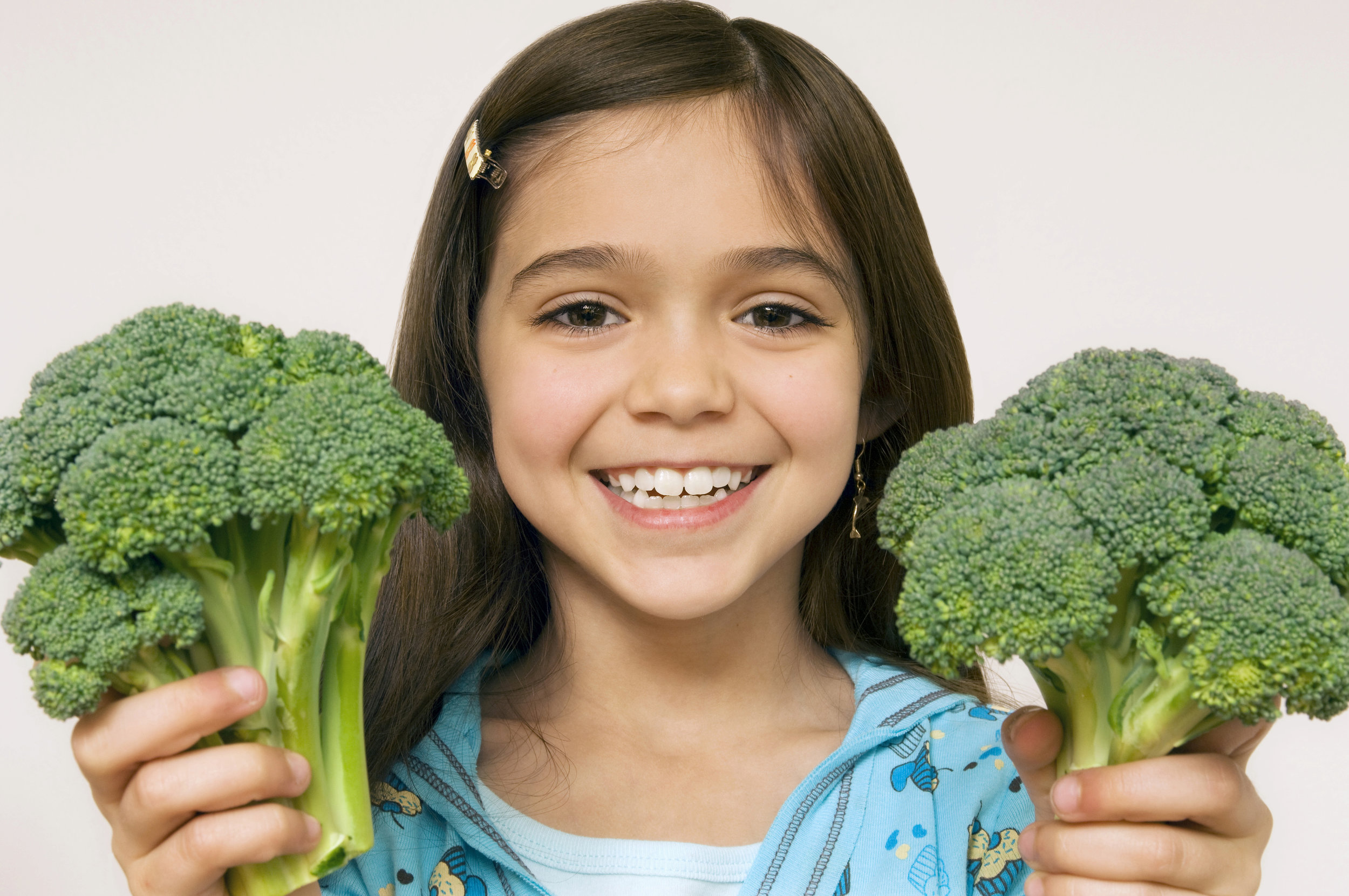 girl holding broccoli.jpg