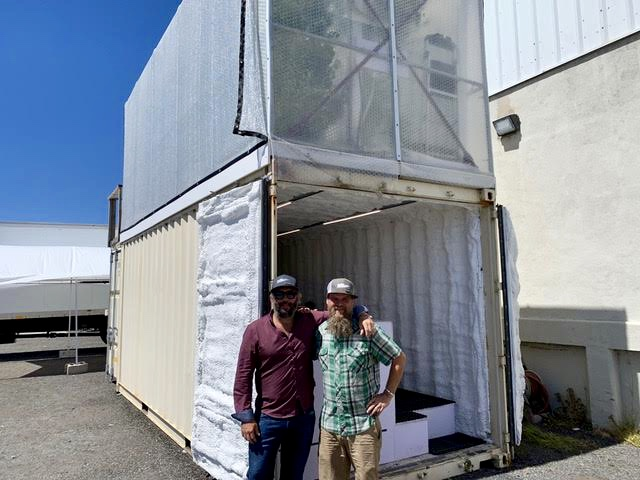 Mike and Beecher in front of our warm weather FarmPod prototype.