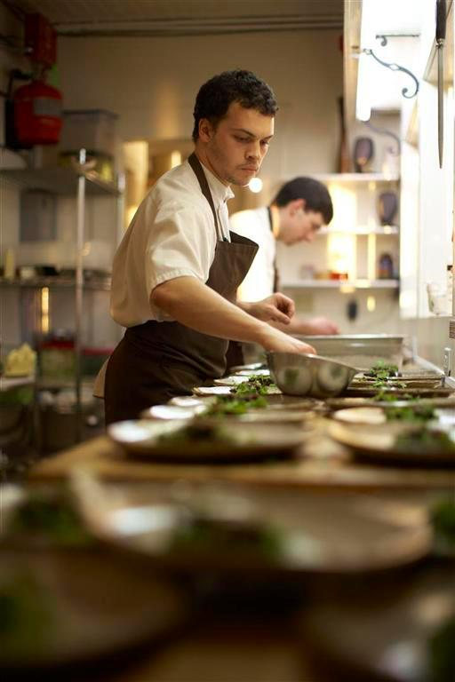 Chefs in action in The Willows Inn kitchen.  Photo by The Willows Inn.