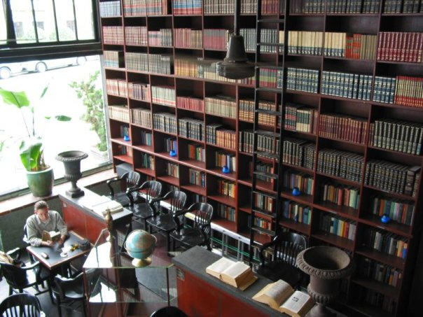 Wall of books inside Bauhaus.  Photo by Bauhaus Books and Coffee.