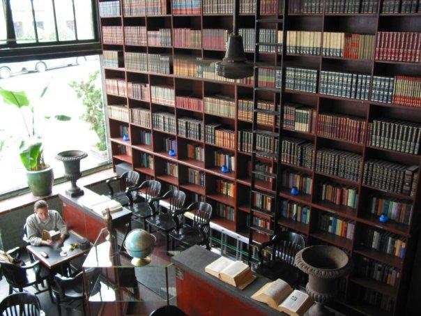 Wall of books inside Bauhaus. Photo by Bauhaus Books and Coffee.
