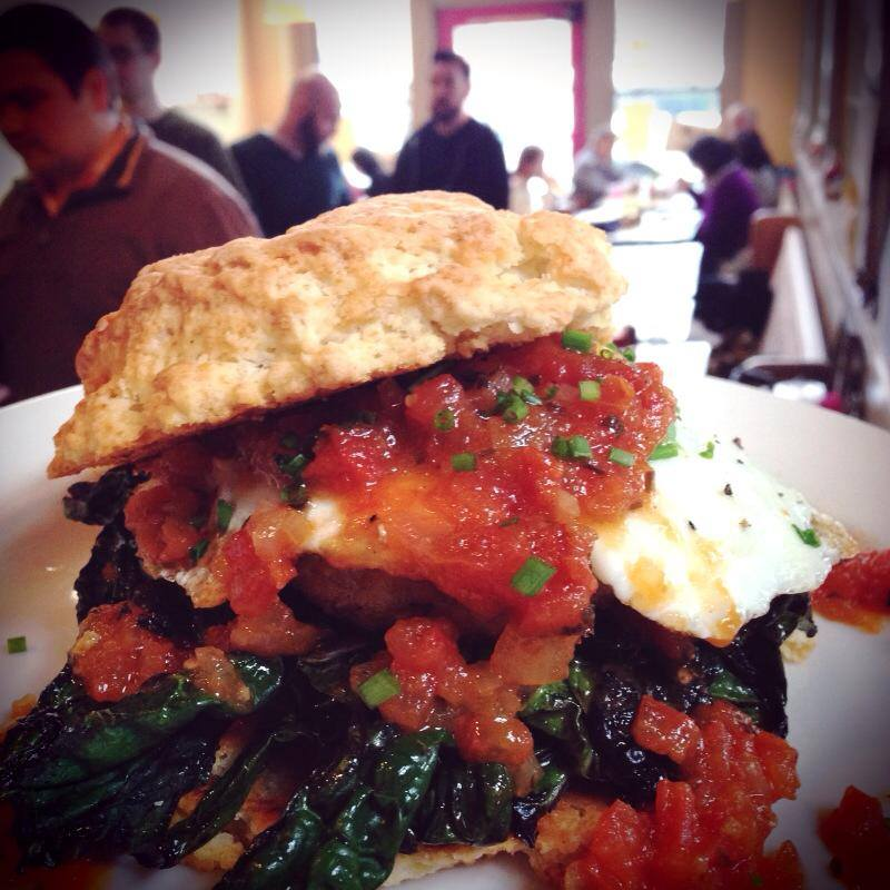 One serious biscuit at The Wandering Goose: housemade sausage, sautéed kale, tomato jam and a fried egg.  Photo by The Wandering Goose.