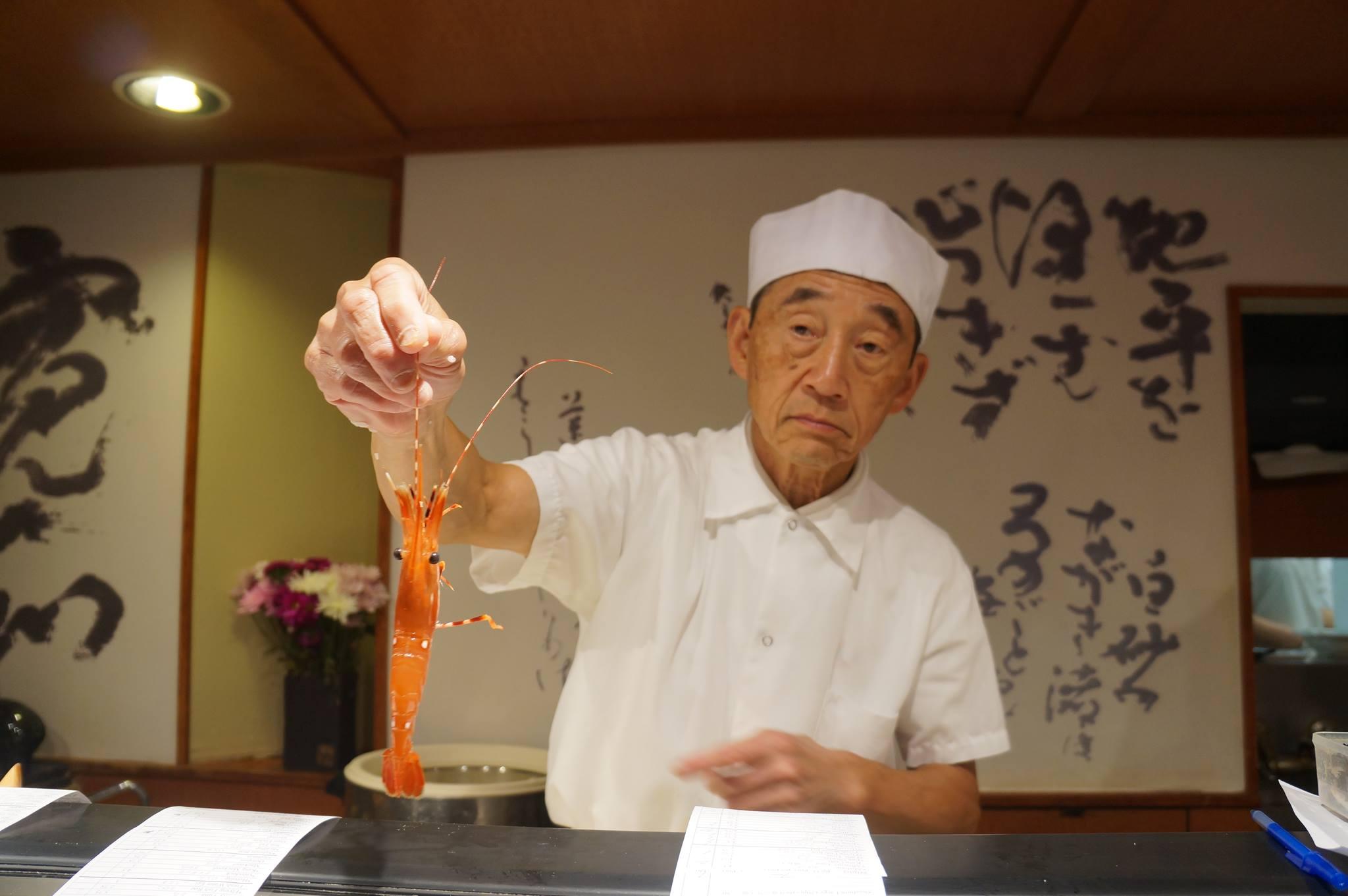 Shiro shows off a fresh catch at his namesake sushi restaurant. Photo by Runei Matsumoto.