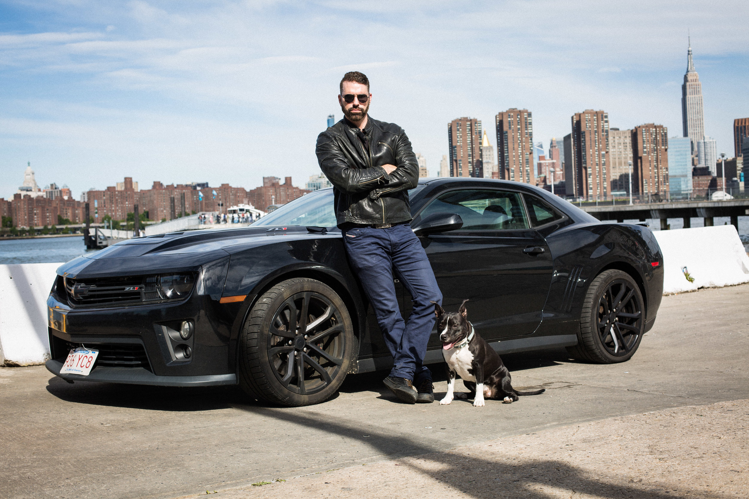 Writer Wolfgang Temple, his car and his dog.