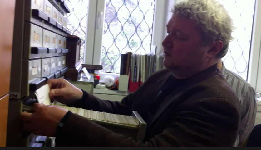 Filmmaker and Fest organizer Dinko Tucaković looking up Peter's feature film files.