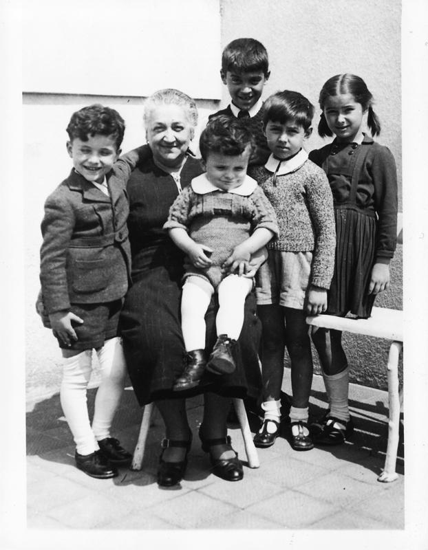Majka Mara with her grandchildren (my cousins) c.1940 Antonije, Misa (on lap), Fedja, Bacika, Maya