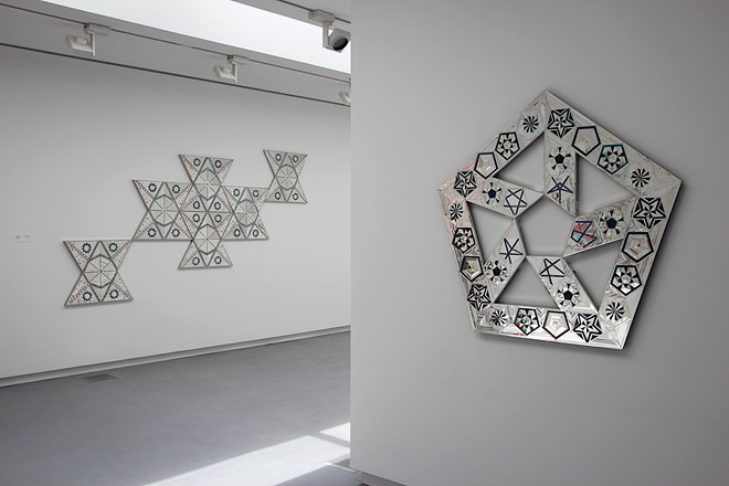 Monir Farmanfarmaian, Untitled 8 and Untitled 1. Mirror and reverse glass painting on plaster and wood. Photo: Haupt & binder.
