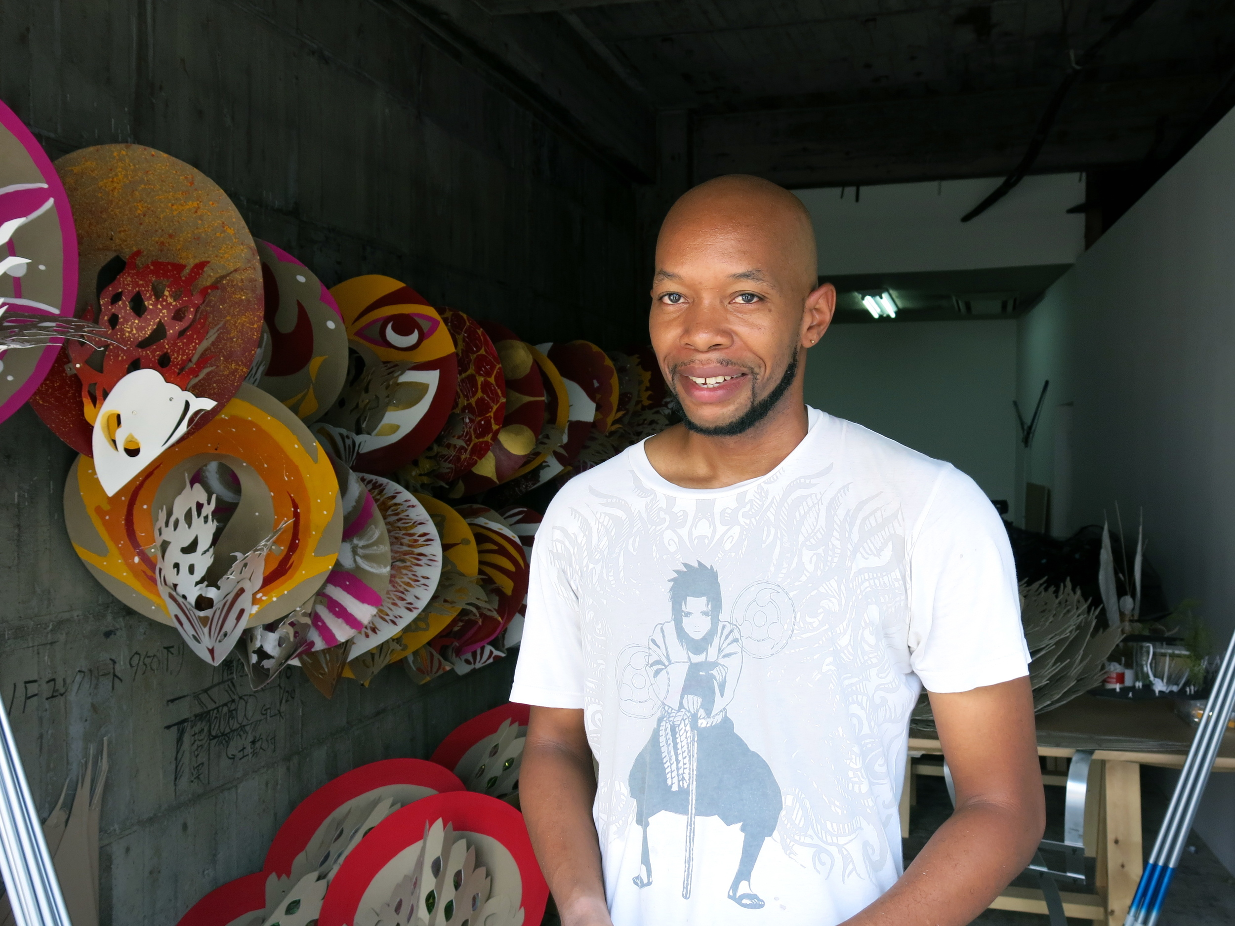 Marlon Griffiths (b.1976) working in his open studio.    Griffiths started out designing Mas (masquerade) costumes for the Carnival in his hometown of   Trinidad and Tobago  .   Choja-machi area.