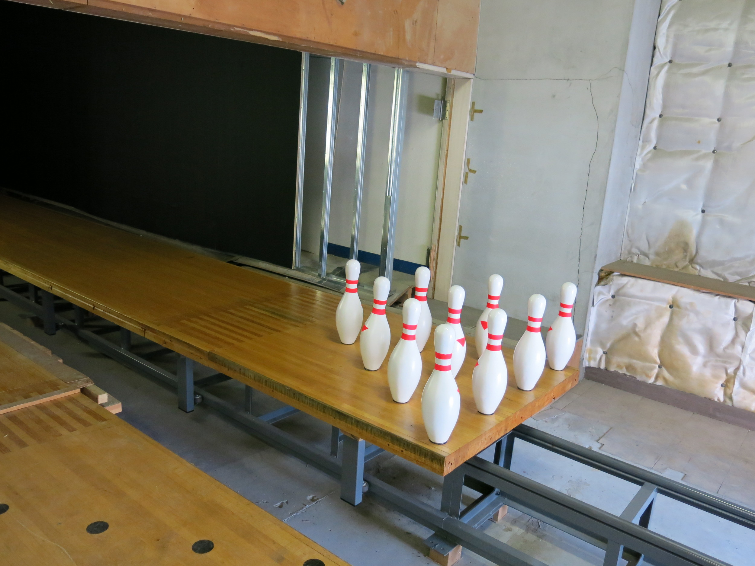 site-specific installation  Lane 61 , 2013. Wilson explains that bowling acts as a metaphor for life; the ball rolls down knocking everything over, yet the pins always come back up.   Toyo Logistics Building.