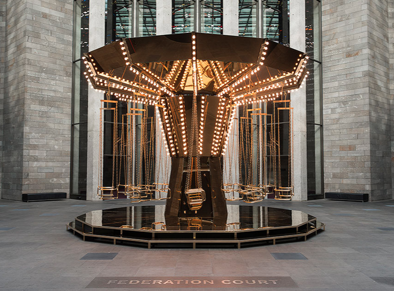Carsten Höller,  Golden mirror carousel,  2014, powder-coated and painted steel, gold-plated stainless steel, tinite-plated stainless steel, brass, mirrors, light bulbs, electric motors, control unit, power unit, sandbags, 480 x 745 cm diameter (variable), collection of the artist, Stockholm and Gagosian Gallery, New York, © Carsten Höller, courtesy Gagosian Gallery. Photograph: Christian Markel.