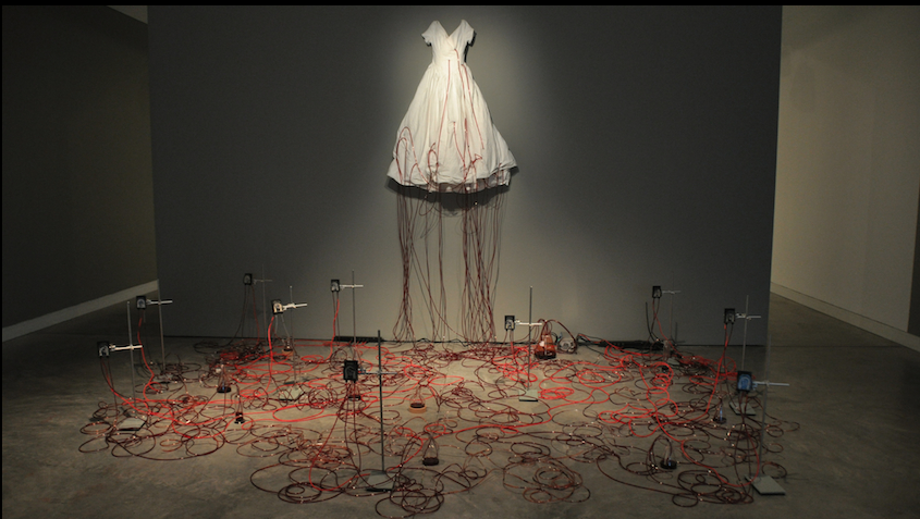 Chiharu Shiota,  Dialogue with absence (installation view),  2010. Pumps, tripods, dress, tubes, coloured electrical cables, glass test tubes, red liquid, dimensions variable. Collection: Gene & Brian Sherman, Sydney. Exhibition: 3 May - 8 June 2013.