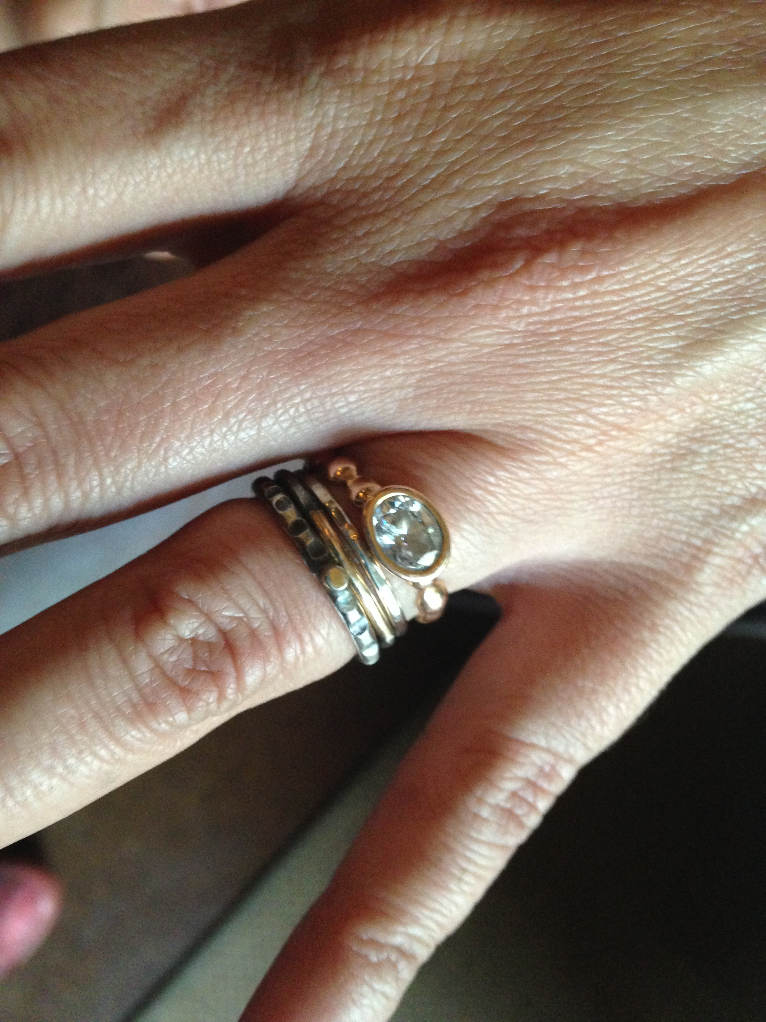 carla's engagement ring (made by another jeweler) + stacking wedding bands. lovely contrast of the rose gold w/oxidized silver + yellow gold.