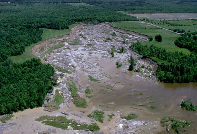 Lemieux Landslide, taken 4 days after the event. The South Nation River has risen 12 m, flooding into the scar. The river is about to overtop the landslide dam at the bottom of the photo.  Photo by S. Evans
