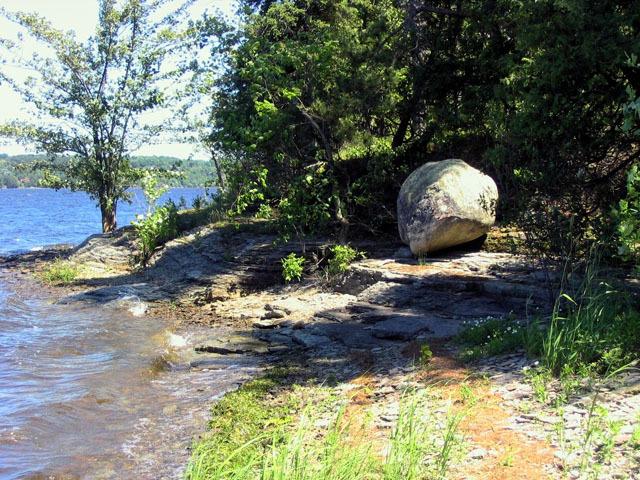 Precambrian erratic boulder on Rockcliffe Formation sandstone, Pinhey's Point.  Photo by J. Aylsworth
