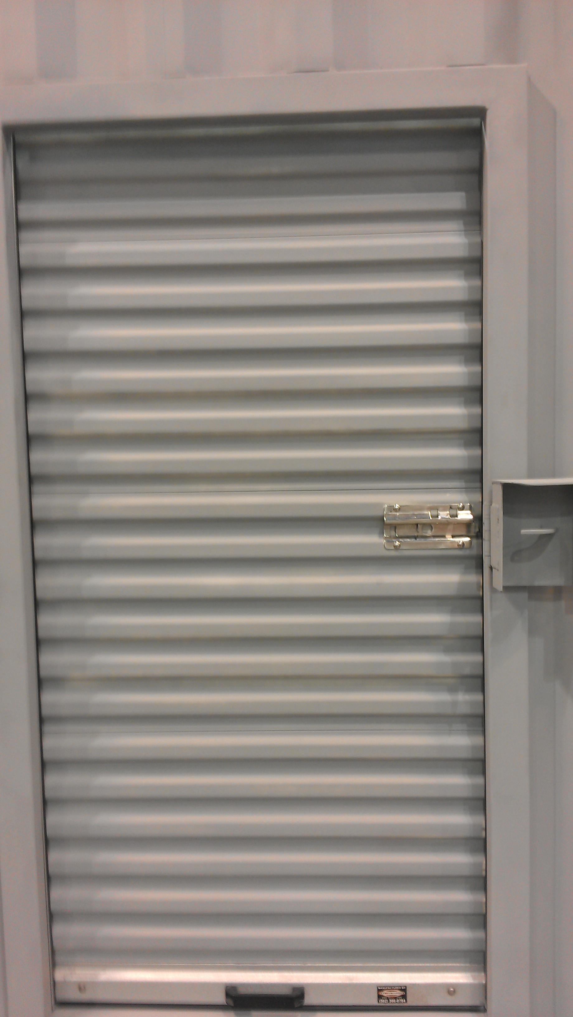 Narrow roll-up door installed with optional lockbox