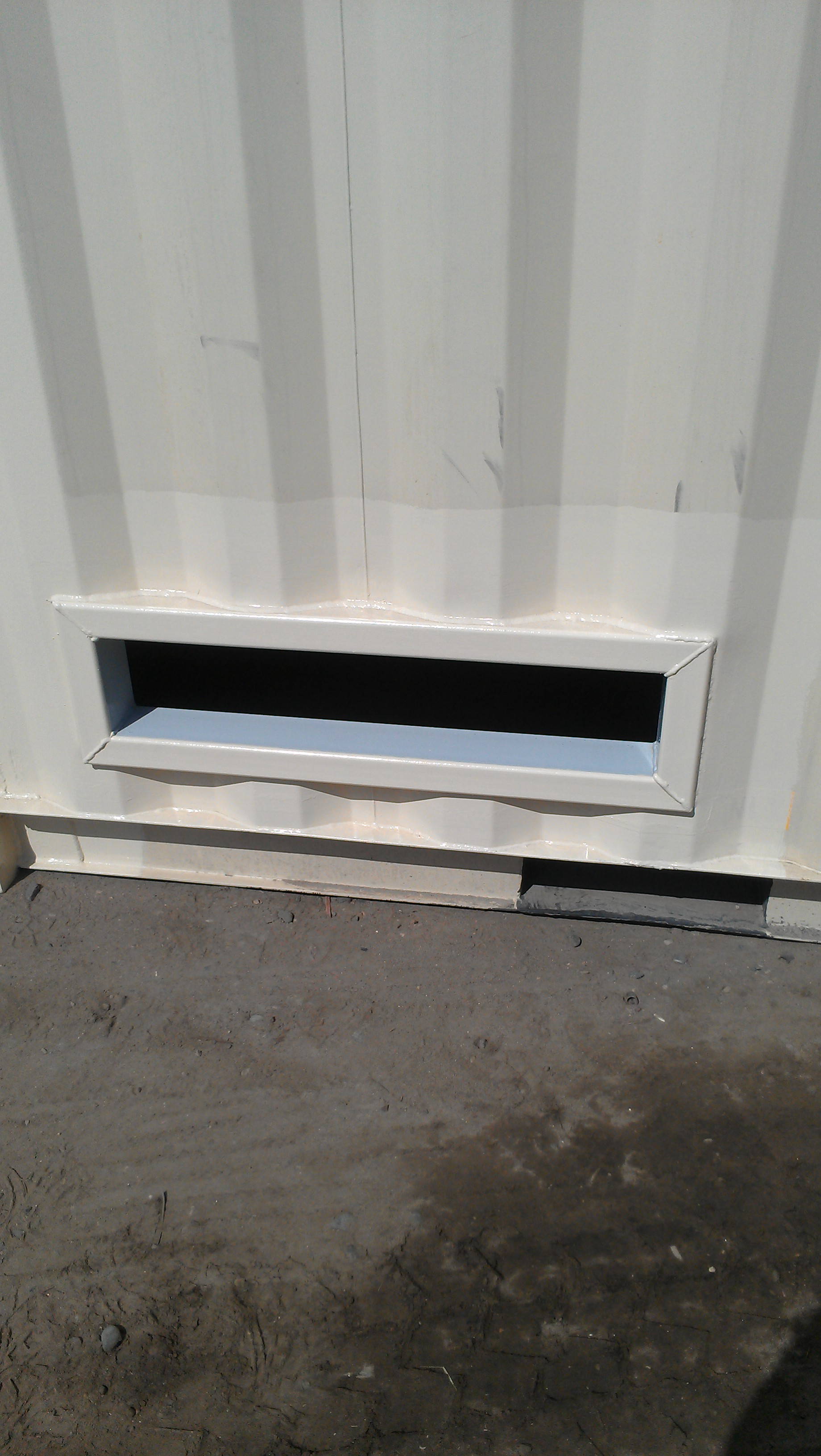 Custom-sized hole in side of conatiner - outside