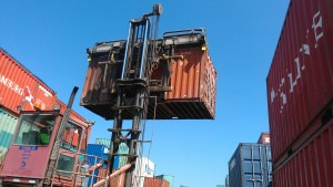 Container forklifts pick up 20's and 40's from the top corner posts