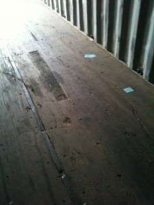 Container floors are made up of sections screwed or riveted to the cross-members