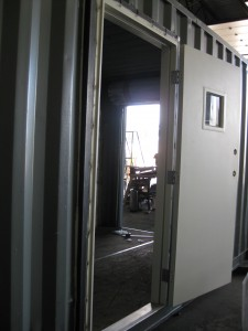 This container is getting an additional service door and roll-up door