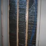 Radiant heat barrier between furring strips
