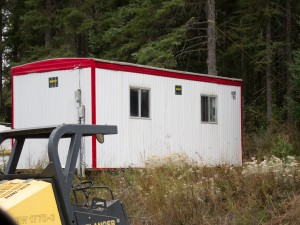 Container-cabin-with-siding-300x225.jpg