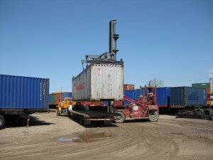 Forklifts and other equipment can move containers around