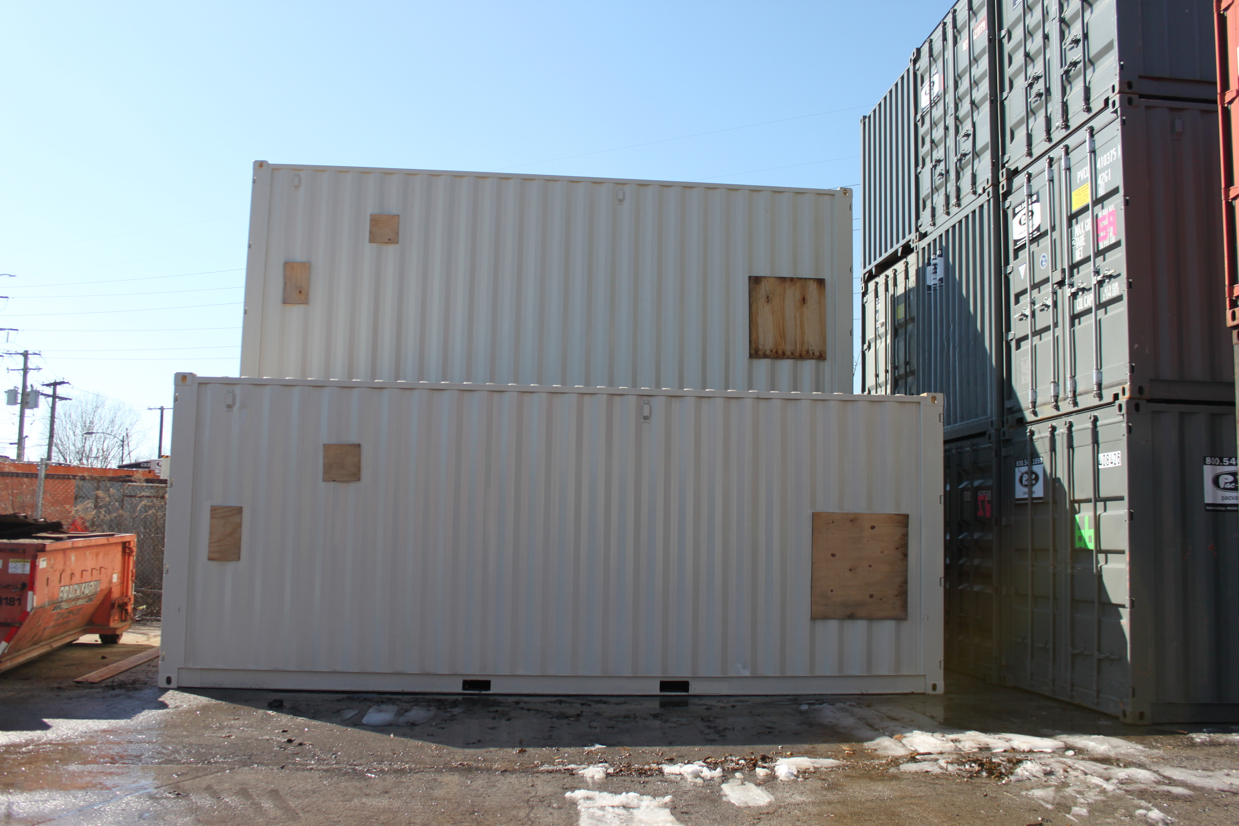 24' modified containers stacked up