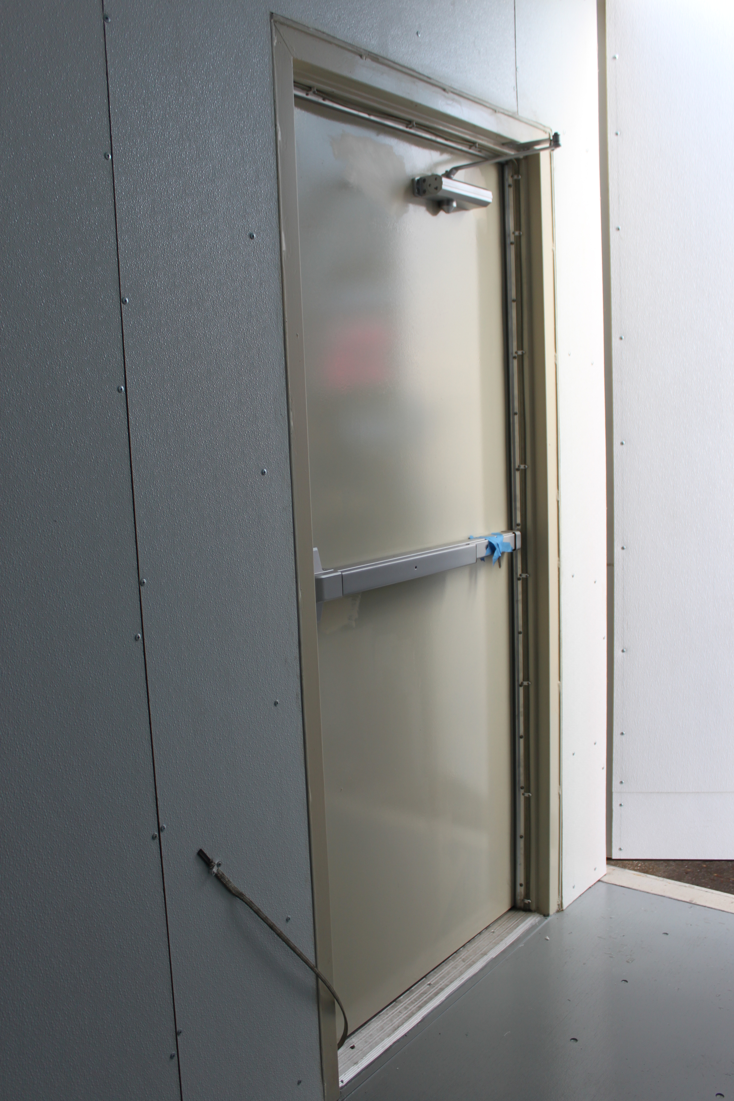Man-door with panic bar (and keys taped to the panic bar)