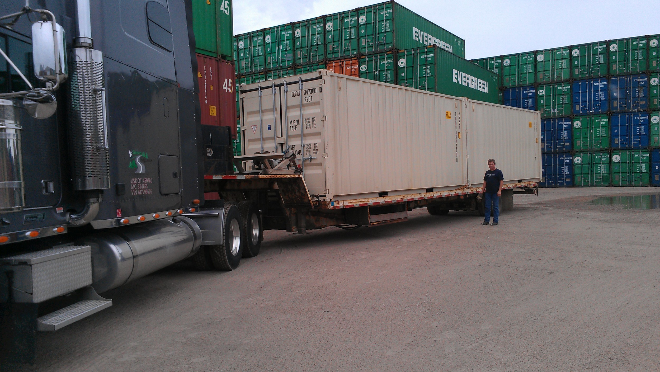 Here are two one-trip 20' containers loaded on a tiltbed truck, all ready to be delivered.