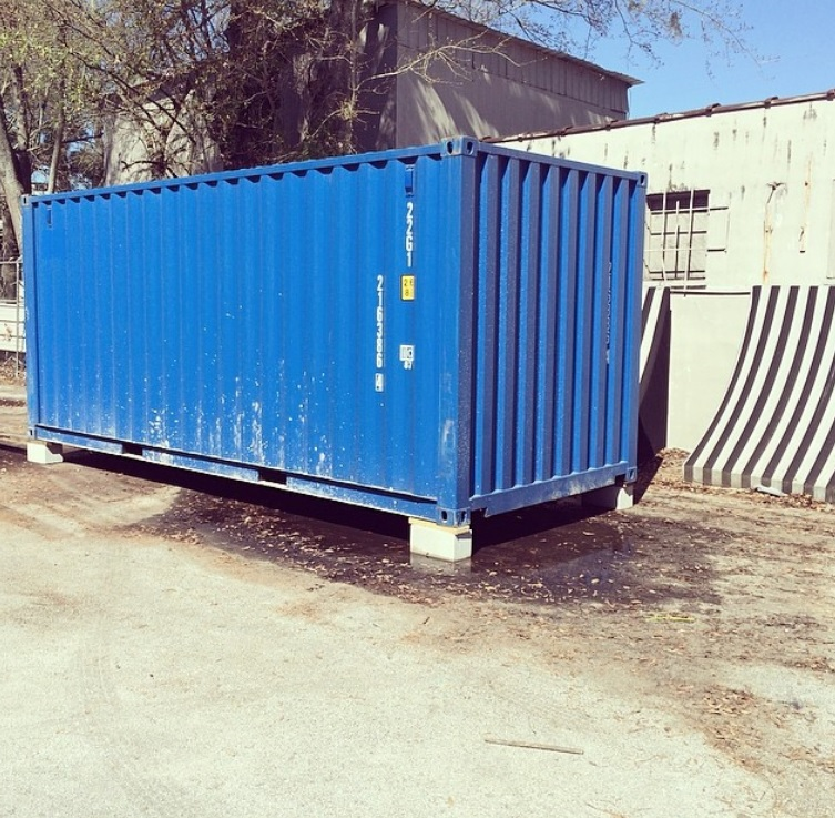 One-trip container next to a workshop