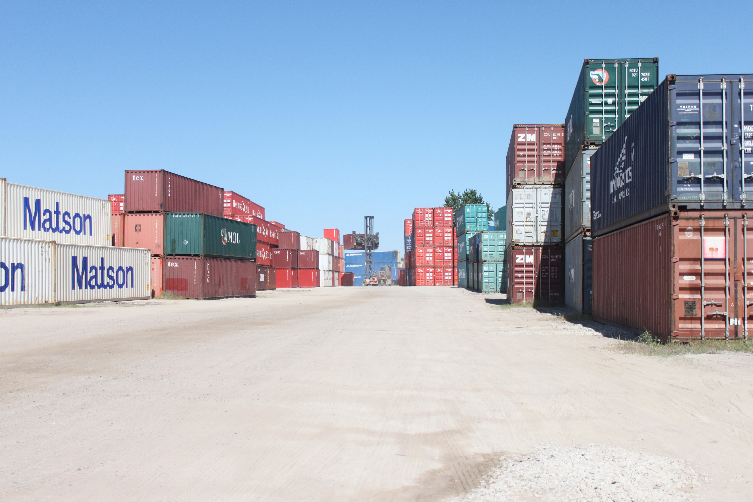 These containers in a container depot are all slated to transport goods to another country