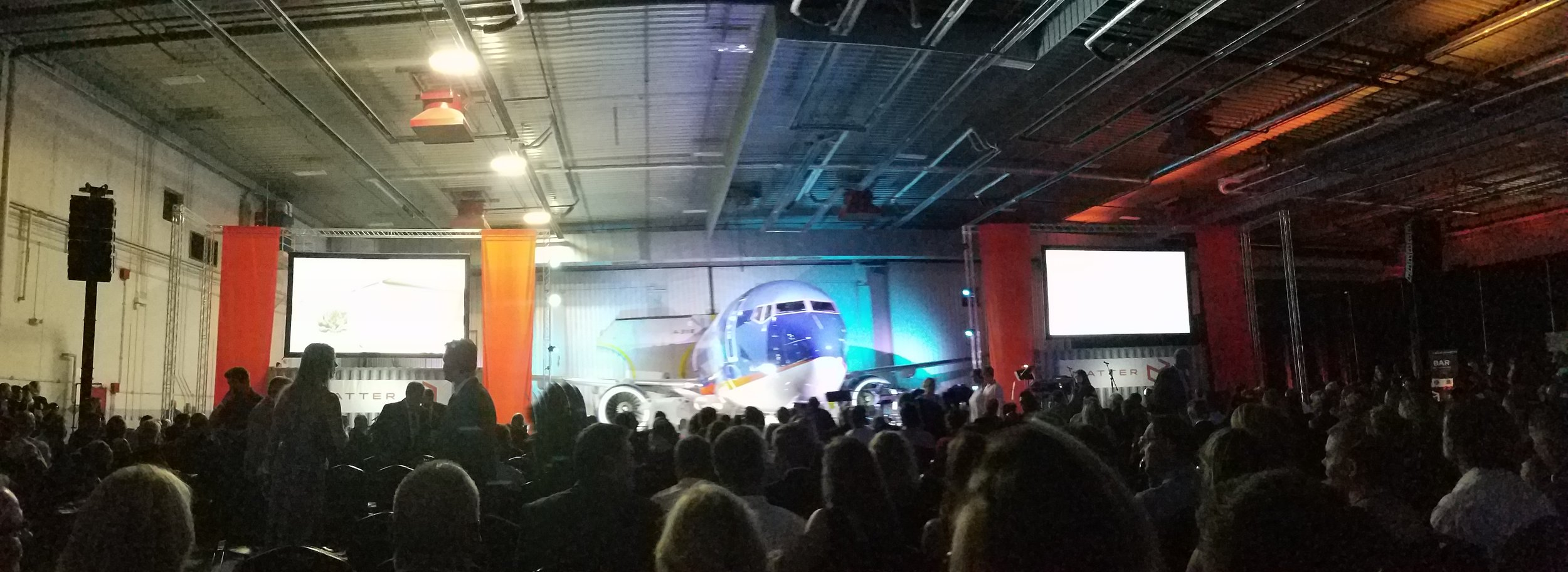 A Night to Matter at Sun Country's cargo hangar.  The stage is set with containers and an airplane