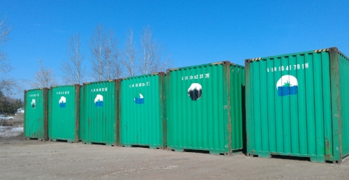 Containers being loaded at customer site