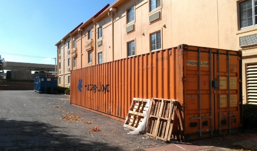 Container by a hotel