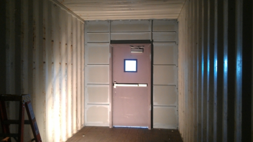 Partition in container with a door