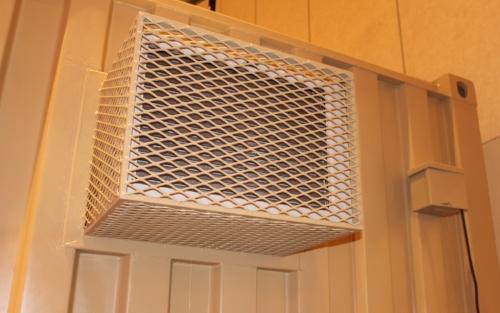 HVAC kit including cage installed