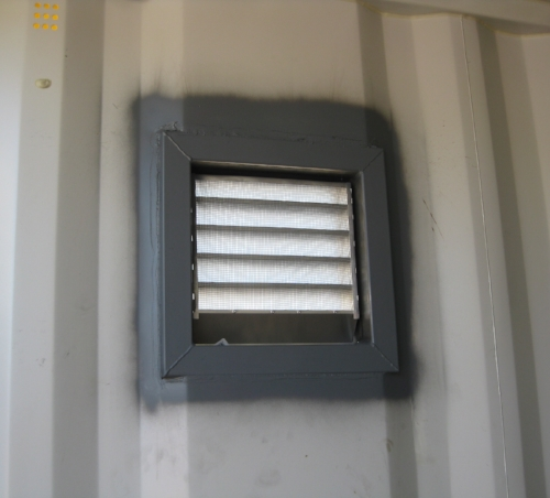 Louvered vent from the inside of a one-trip container