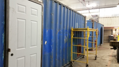 A man-door added to a used container
