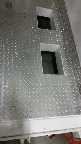 Floor cut-outs with diamond-plate flooring