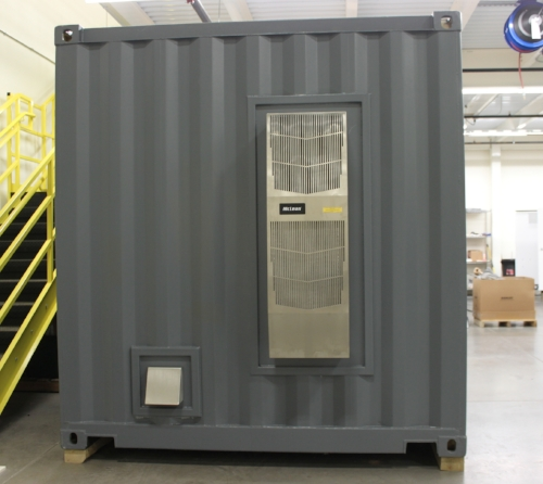 HVAC unit installed on outside of container