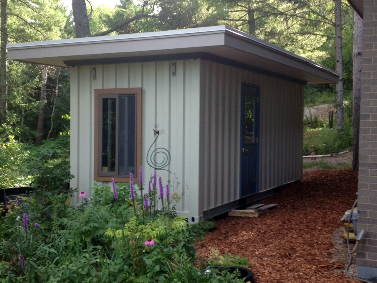 A Super Cubes customer converted this 20' container into a beautiful garden shed